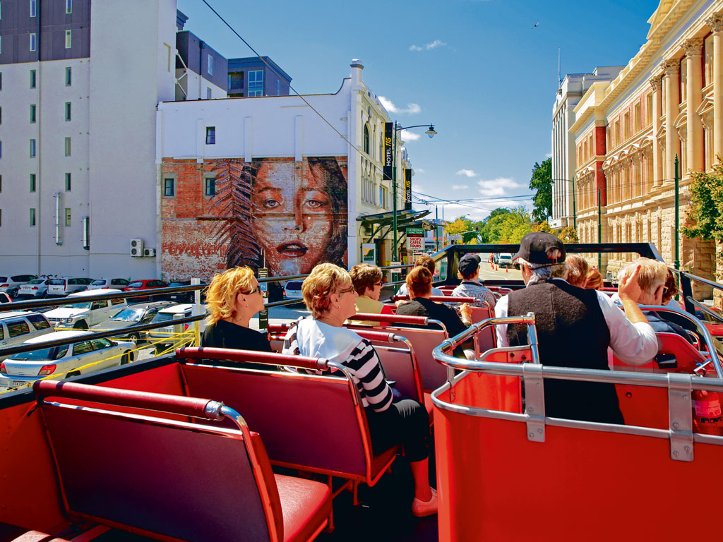 Open-air buses are a popular way to see Christchurch, but walking the city is really the way to enter its creative heart. Photo by: Artazum/Shutterstock