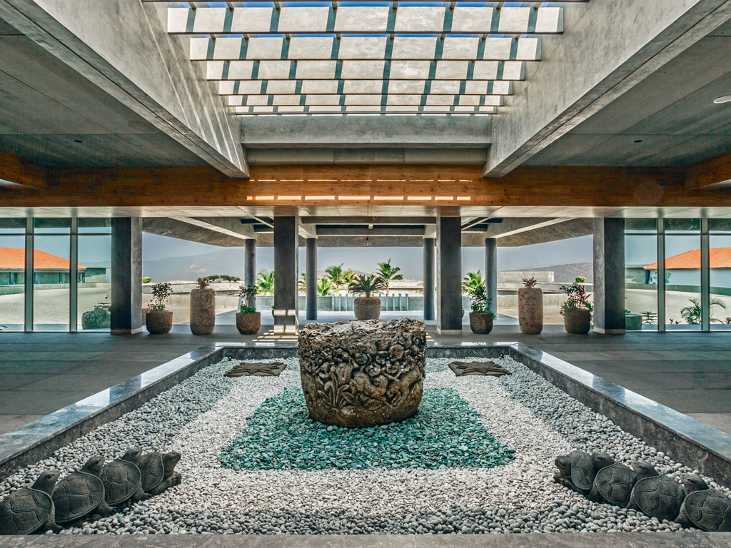 Balinese sculptures and a koi pond in the resort's airy foyer set the mood for a relaxed, luxurious stay. Photo courtesy: BayPark by Pema Wellness