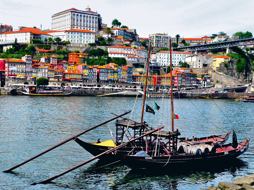 The 2,000-year-old history of the old town of Porto unfolds along Douro River, which ferries rabelos, or traditional boats, carrying about 80 casks of port every day.