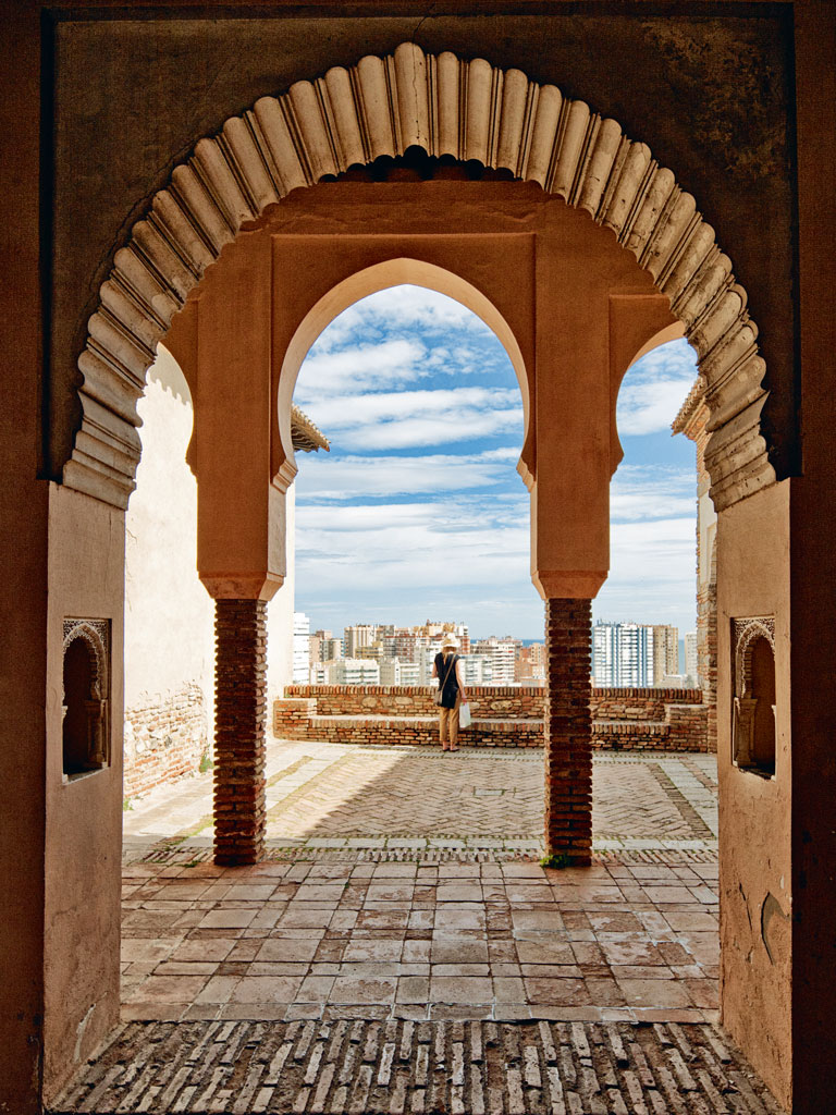 Lording over Málaga from a hilltop, the medieval Alcazaba fort exemplifies how the city's Catholic heritage is still leavened with traces of its Islamic past. Photo by: Urbancow/Getty Images
