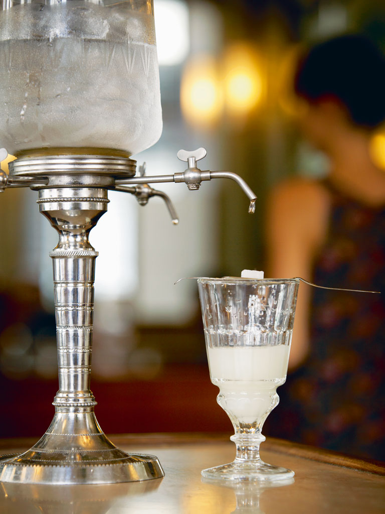 When mixed with water absinthe usually takes on a cloudy appearance. Photo by: Cultura RM Exclusive/Philip Lee Harvey/Cultura Exclusive/Getty Images