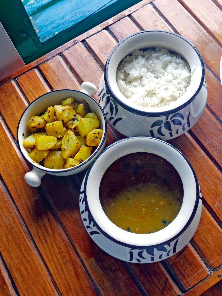 A typical Kumaoni meal served at the stay includes locally grown rice and black soya bean gravy. Photo by: Joana Lobo