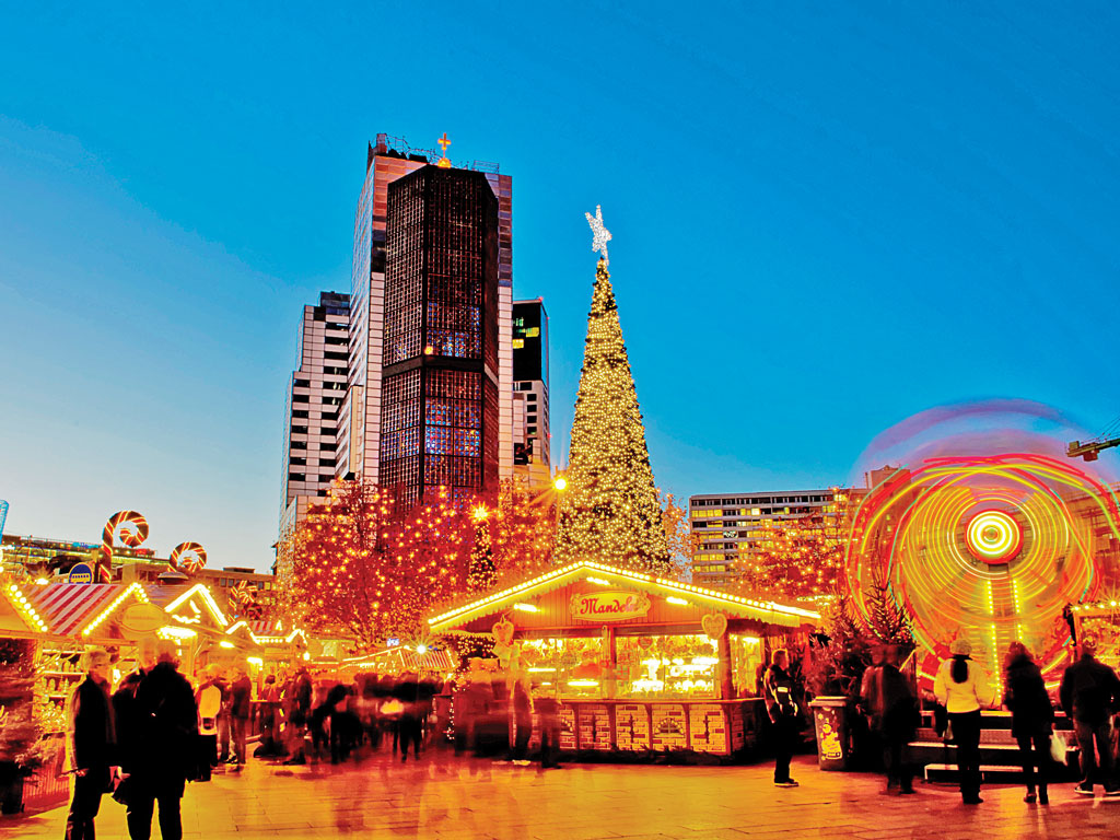 A Christmas market in Berlin. Photo by Ingo Jeziersk/Photographer's Choice RF/Getty Images.