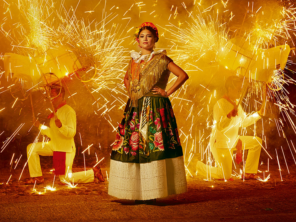 During a festival in Ciudad Ixtepec traditional gowns embroidered with silk flowers dazzle as brightly as a shower of fireworks. Photo by Diego Huerta.