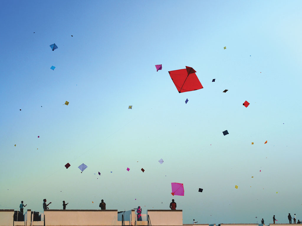 Locals and tourists bring out their best kites to put up an ariel spectacle. Photo by: Anand Purohit/Getty Images