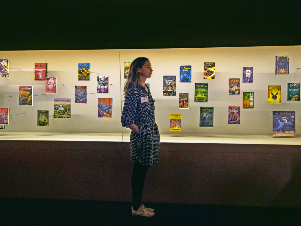 A wall at the exhibit is lined with the cover designs of the books' 81 translated versions. Photo by: Victoria Jones - pa images/contributor/pa images/Getty Images