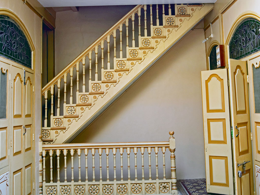 The staircase at the Saifuddin Vagh House, a Bohra-owned mansion, leads to a secret, cloistered world.