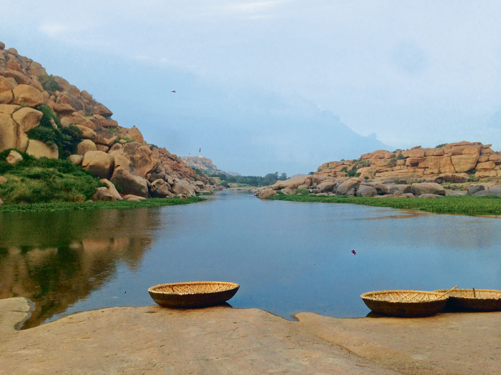 Lazy evening along the Tungabhadra could be spent on coracle rides and watching the sun set over the boulders. Photo by: Joanna Lobo
