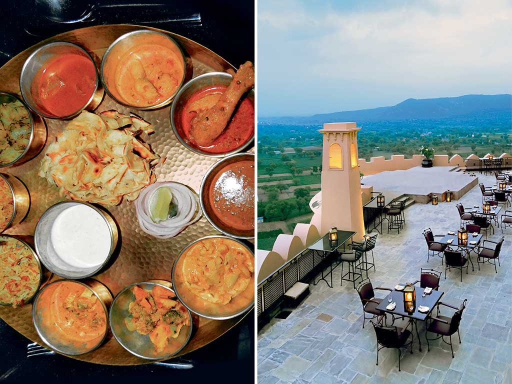 The rooftop terrace dining area (right) at the hotel commands majestic views, and is perfect to dig into the rustic spread served here. A princely thali (left) at the Alila Fort Bishangarh has varieties of robust meats and spicy vegetable preparations. Photo courtesy: Alila Fort Bishangarh (restaurant); Photo by: Zac O'Yeah (food)
