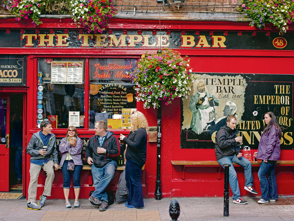 "The popular Temple Bar pub anchors the namesake district, which the author says is ""a bit like a tiny Times Square."" Photo by Bernd Jonkmanns/laif/Redux."