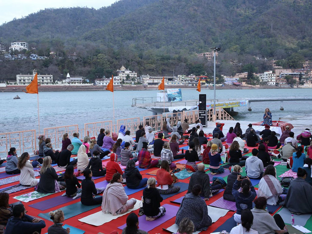 At the annual International Yoga Festival, practice yoga by the Ganges in Rishikesh at Parmarth Niketan ashram. Photo courtesy: International Yoga Festival