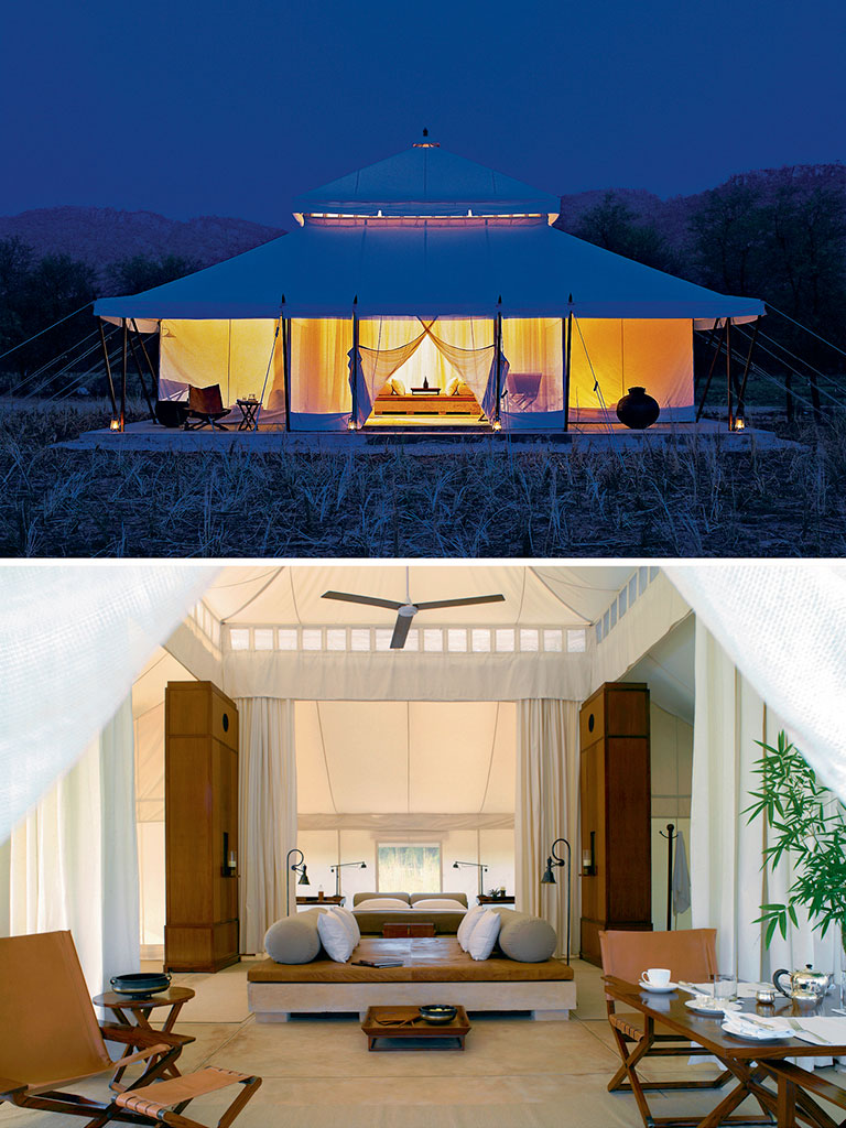 At nightfall, Aman-i-Khas's Mughal tents blend into the wilderness (top). But inside (bottom) they have all the creature comforts, and warm touches such as a wildlife storybook by the bed and a vintage leather cooler filled with beer. Photos Courtesy: Aman Resorts