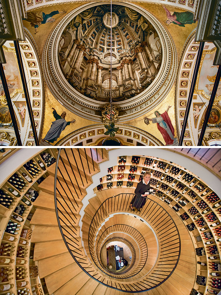 The ceiling art in Malta's Gozo Cathedral (top) is a fine example of baroque art trickery. It creates an illusion of a dome. Inside the L'Intendant (bottom), a five-storey-high circular tower houses some of Bordeaux's finest wines. Photos by: John Turp/Moment/Getty Images (ceiling), Holger Leue/LOOK-foto/LOOK/Getty Images (staircase).