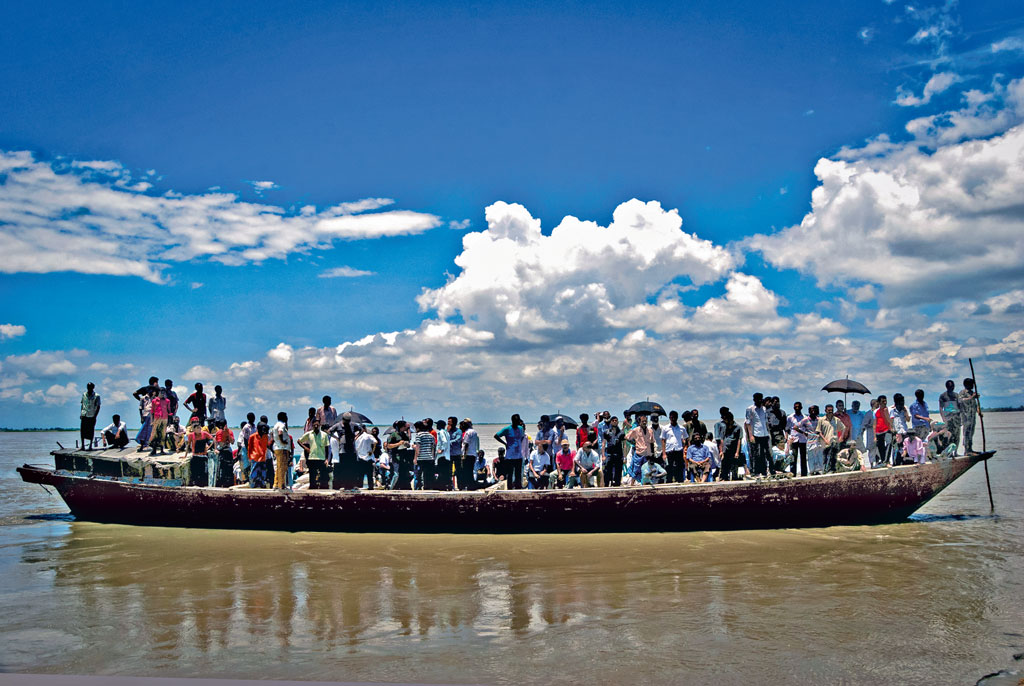 Boats taking passengers to and from the islands, locally known as chars, are often perilously overcrowded. Photo by: Shibu Bhattacharjee/Moment Open/Getty Images