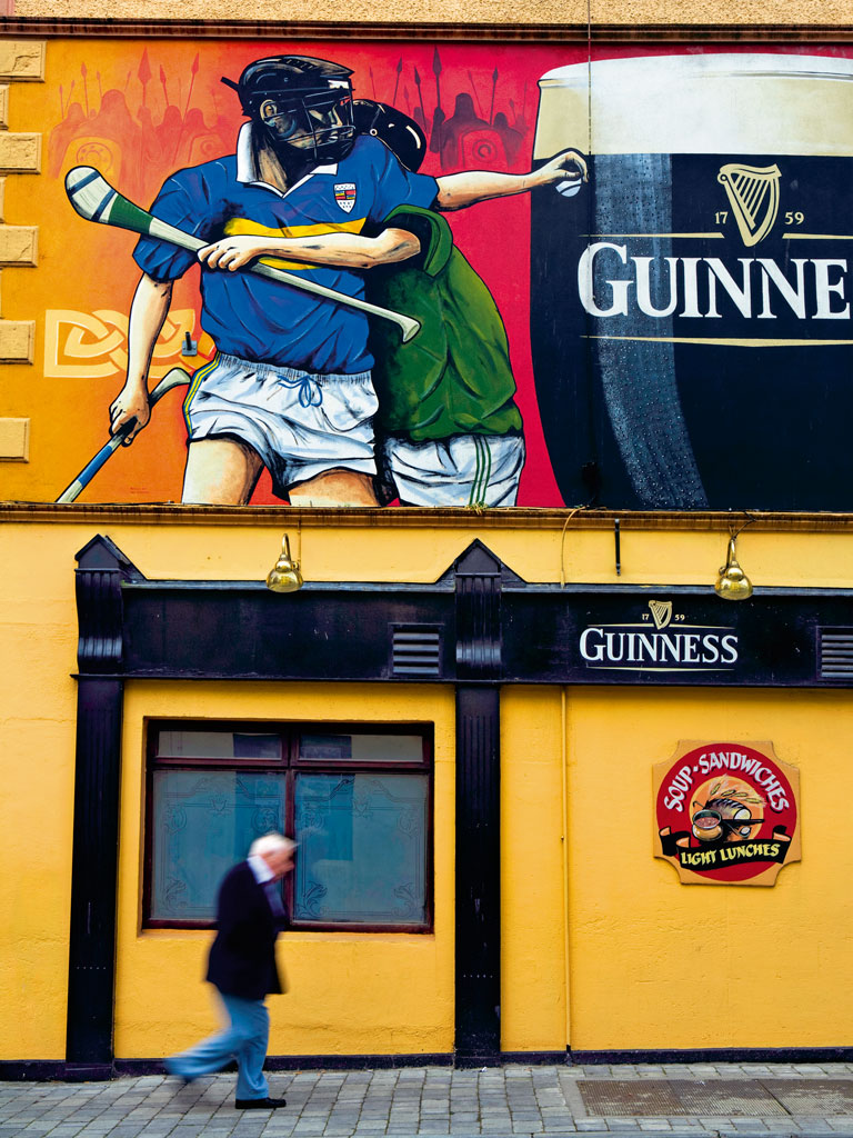 Even the smallest Irish town has a pub selling frothy mugs of Guinness, the popular Irish stout beer. Photo by: Douglas Pearson/Corbis Documentary/Getty Images