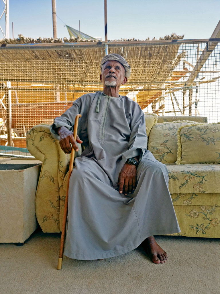 Juma Hassoon Al-Araimi or Uncle Juma (bottom), one of the last master carpenters in Oman, has a factory where dhows have been built for about 45 years. Photo by: Sonal Shah