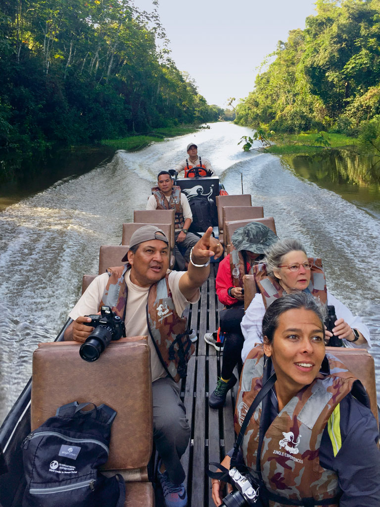 A wooden skiff racing along Amazonian creeks and rivers opens up a new window into its stunning ecosystems. Excursions with naturalist Juan Tejada (first, left) often include sightings of toucans and hummingbirds, and hilarious imitations of a sloth bear looking for his mate. Photo by: Kareena Gianani