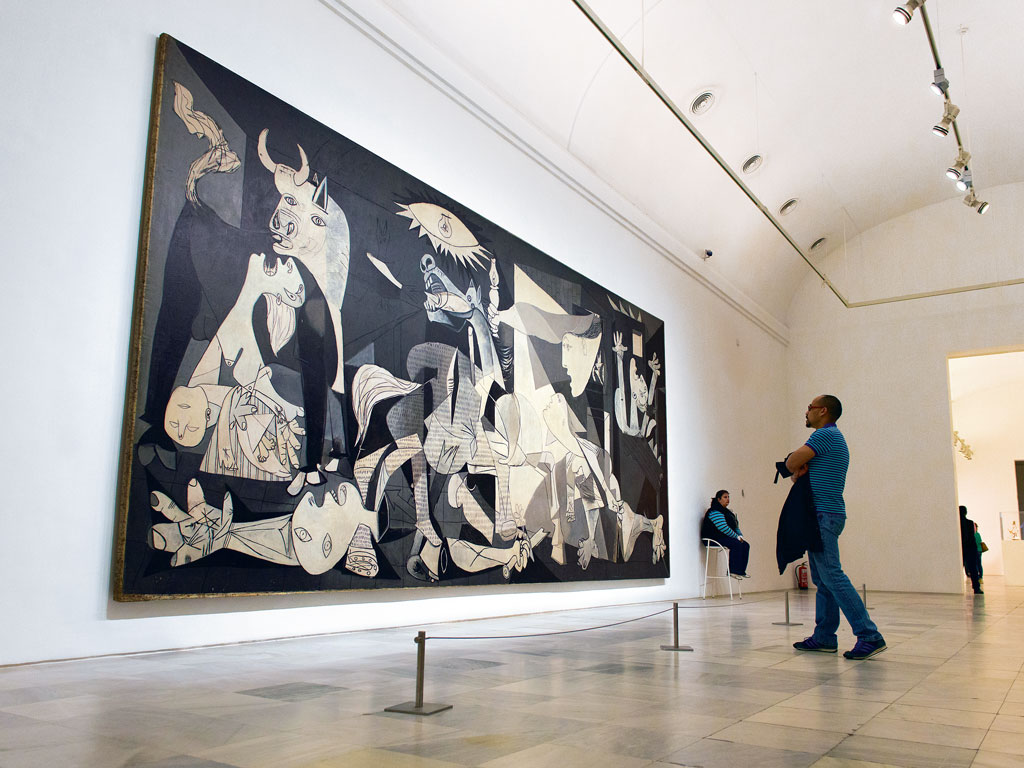 """Guernica"", Pablo Picasso's depiction of the Spanish Civil War, and one of his most famous works, hangs inside the Reina Sofia museum. Photo Courtesy: Madrid Destino Cultura Turismo Y Negocio, S.A. available at www.esmadrid.com"