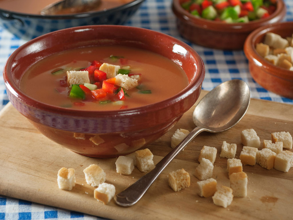 Gazpacho is a tomato broth bursting with onions and peppers; sweet and sour and spicy all at once. Photo by ©Simon Reddy/Alamy/indiapicture.