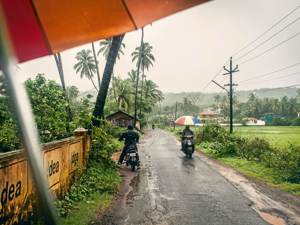 Villagers in Goa are  adept at manoeuvring two-wheelers through heavy downpours.