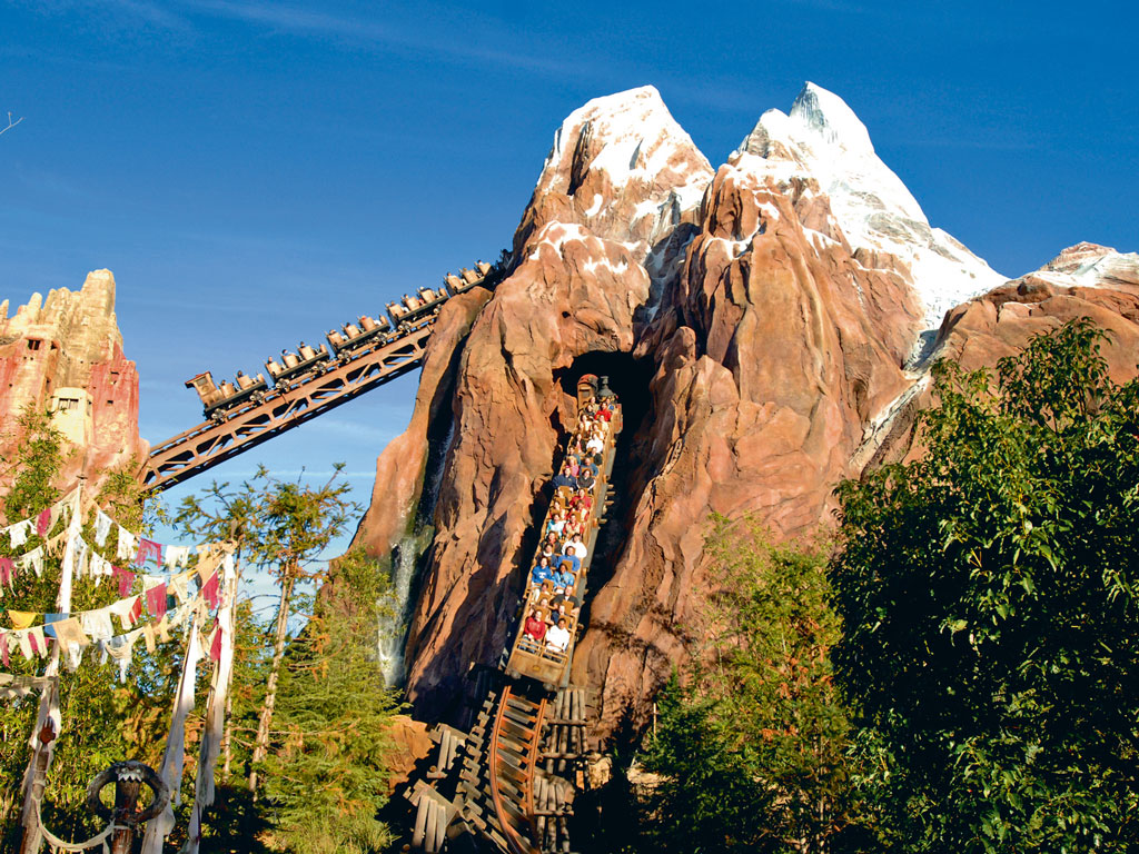 Highlights at the Walt Disney World resort include the Expedition Everest roller coaster, whose backdrop is built to resemble the mountain's basecamp. Photo Courtesy:  Walt Disney Parks and Resorts