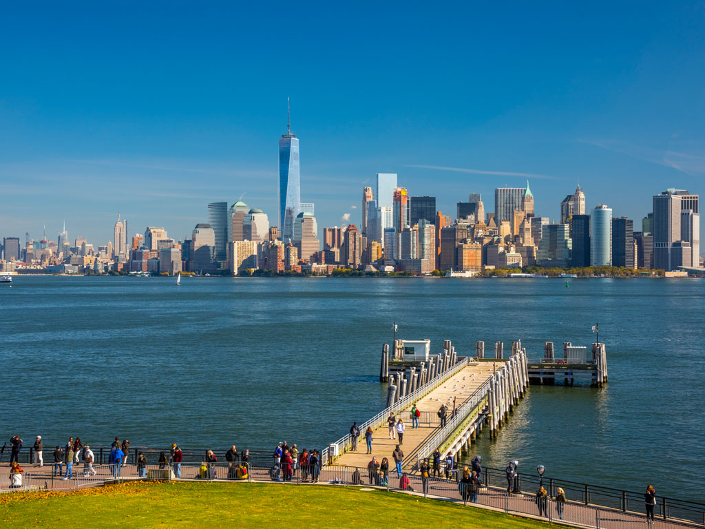 New Jersey's many waterfront parks are ideal spots to spend an evening enjoying the view of the New York skyline and the Statue of Liberty. Photo by Alan Copson/AWL Images/Getty Images.