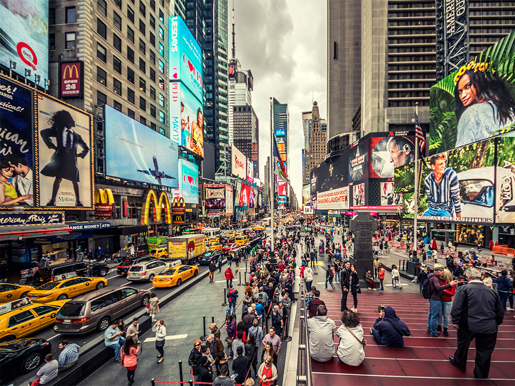 The theatre district to the shopping hub, from laid-back locals to wide-eyed tourists, from giants LCD billboards and costumed revellers to neon-red stairs and quiet corner spots—Times Square is the most visited and most Instagrammed part of New York. Photo by Zsolt Hlinka/Moment/Getty Images.
