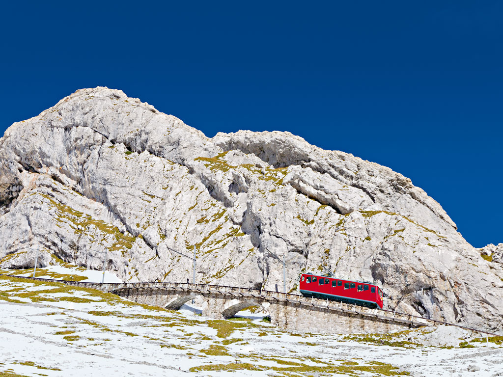 Commissioned in 1889 and with a gradient of up to 48 per cent, Lucerne's Mount Pilatus cog train is the steepest cogwheel railway in the world. Photo by: Martin Lehmann/Alamy