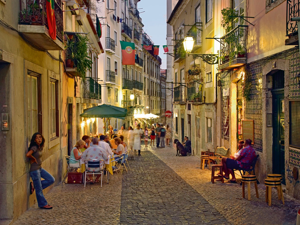 Lisbon's weather, genial for most part of the year, makes al fresco dining (right) a common feature in the city. Photo by Demetrio Carrasco/Getty images