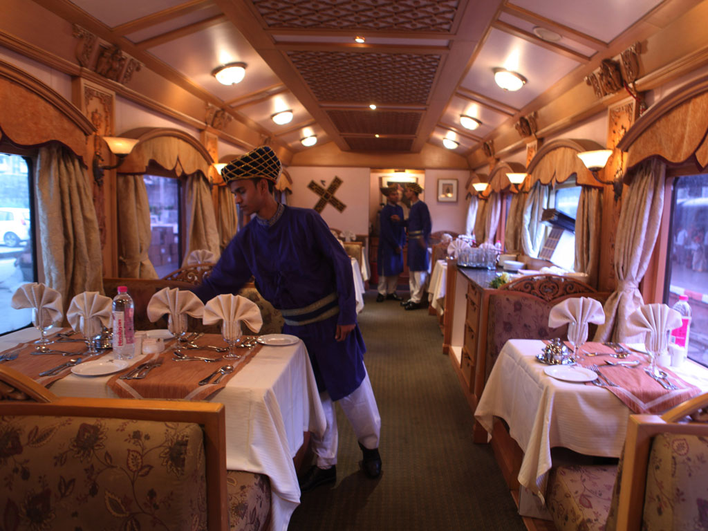 The 21-coach luxury Deccan Odyssey is inspired by the imperial carriages of erstwhile maharajas and apart from comfortable rooms, also has a dining coach, lounge, conference car and health spa. Photo by Hindustan Times/ Contributor/ Hindustan Times/ Getty Images,