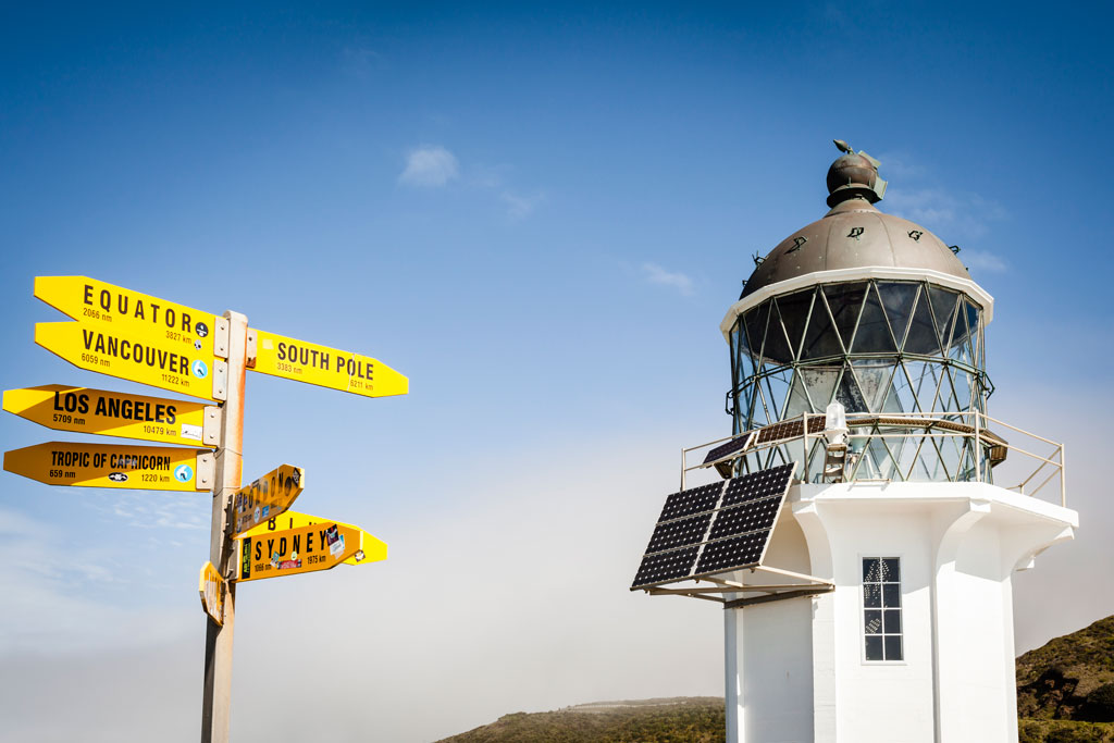The 32-foot-high Cape Reinga lighthouse, perched on a headland in Northland, affords sweeping views of the Pacific Ocean. Photo by: Jorge Duarte Estevao/Getty Images