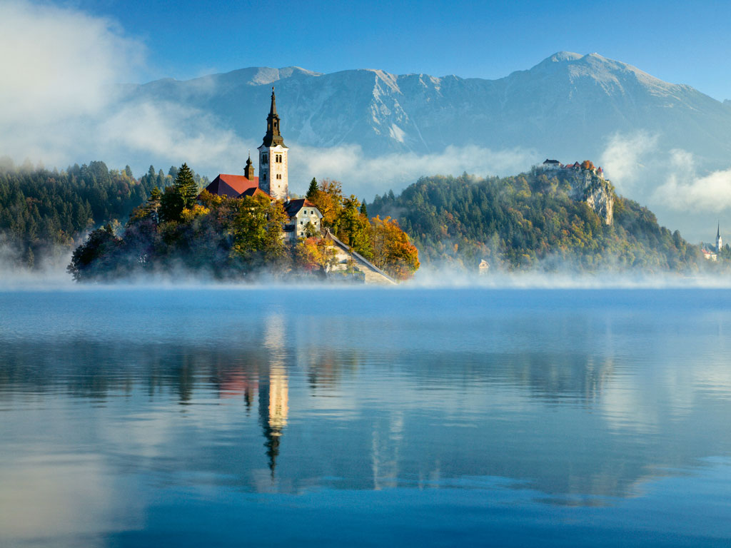 The 17th-century Santa Maria Church, standing on a quaint island in Slovenia's Lake Bled, looks straight out of a postcard. Photo by: Guy Edwardes/Getty Images