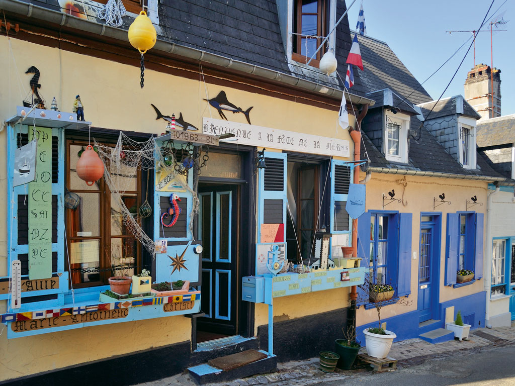 In Saint-Valery-sur-Somme, narrow sloping streets are lined by cottages belonging to fisher folk. Many of the houses have quirky fishing decorations. Photo by: Clément Philippe/Dinodia Photo Library