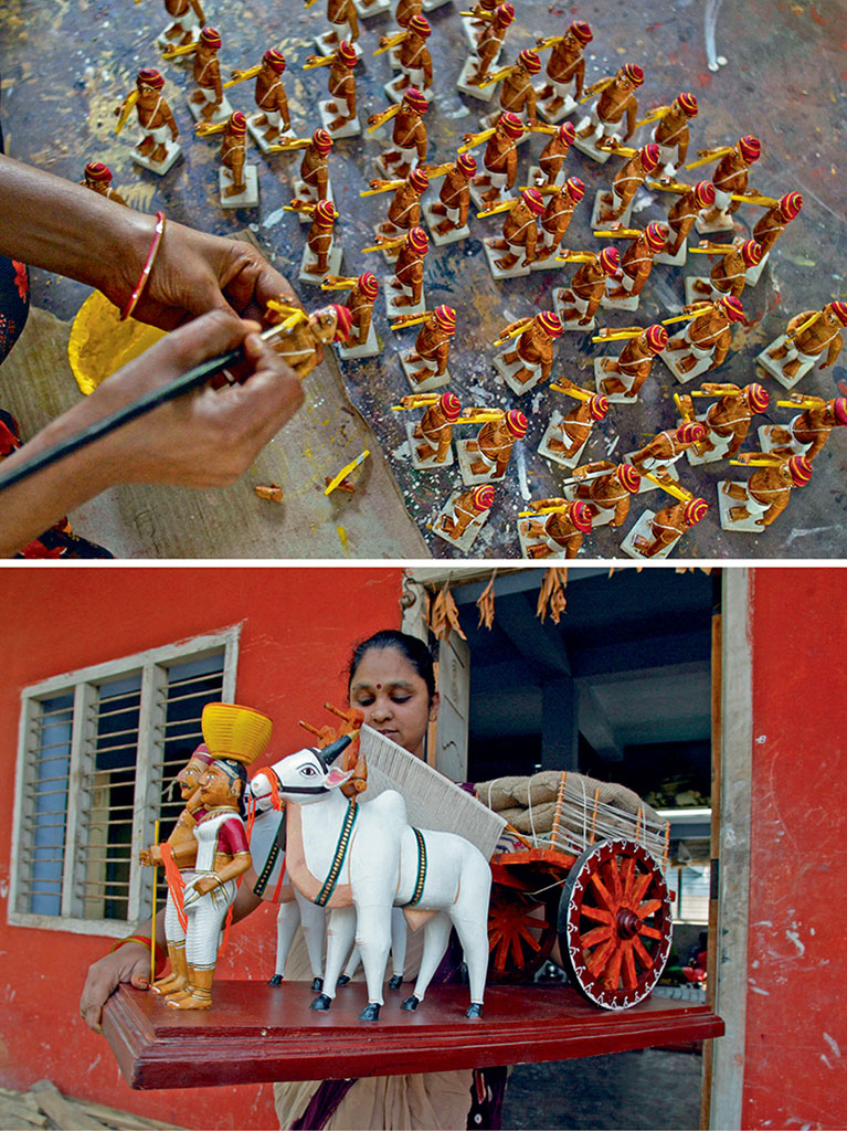 Brightly painted wooden toys of gods and goddesses, dancing girls with tilting heads, bullock carts (bottom) and figures of all kinds (top) are painstakingly put together following a rigorous step-by-step procedure. Photos by NOAH SEELAM/Stringer/Getty Images.