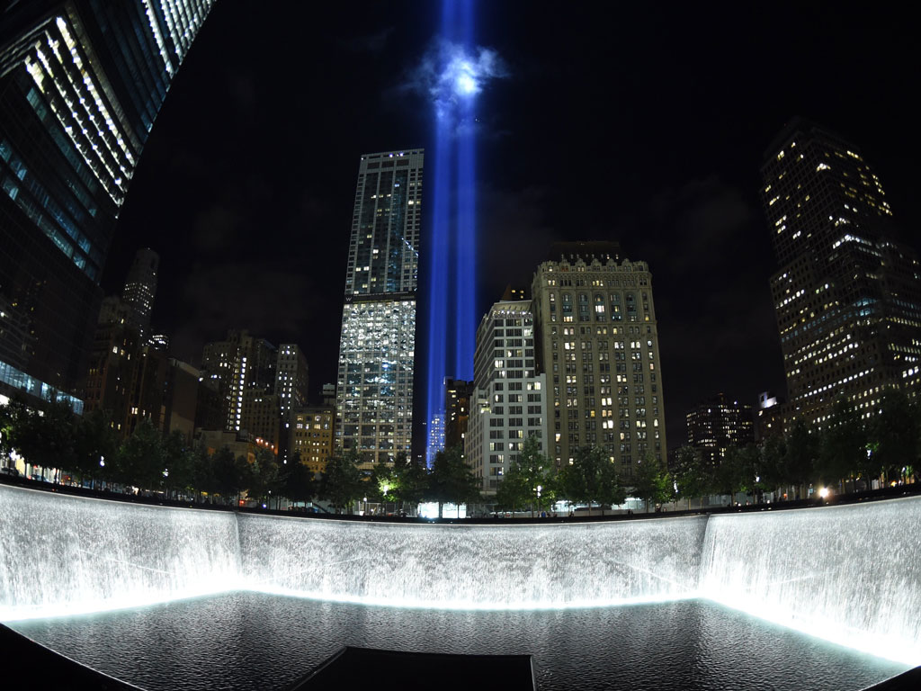 The Tribute in Light, an art installation by the Municipal Art Society, consists of 88 searchlights that create two vertical columns of light. It illuminates the sky behind the 9/11 Memorial waterfalls every year on 11 September in remembrance of the 2001 attacks. Photo by Timothy A. Clary/Staff/AFP/Getty Images.
