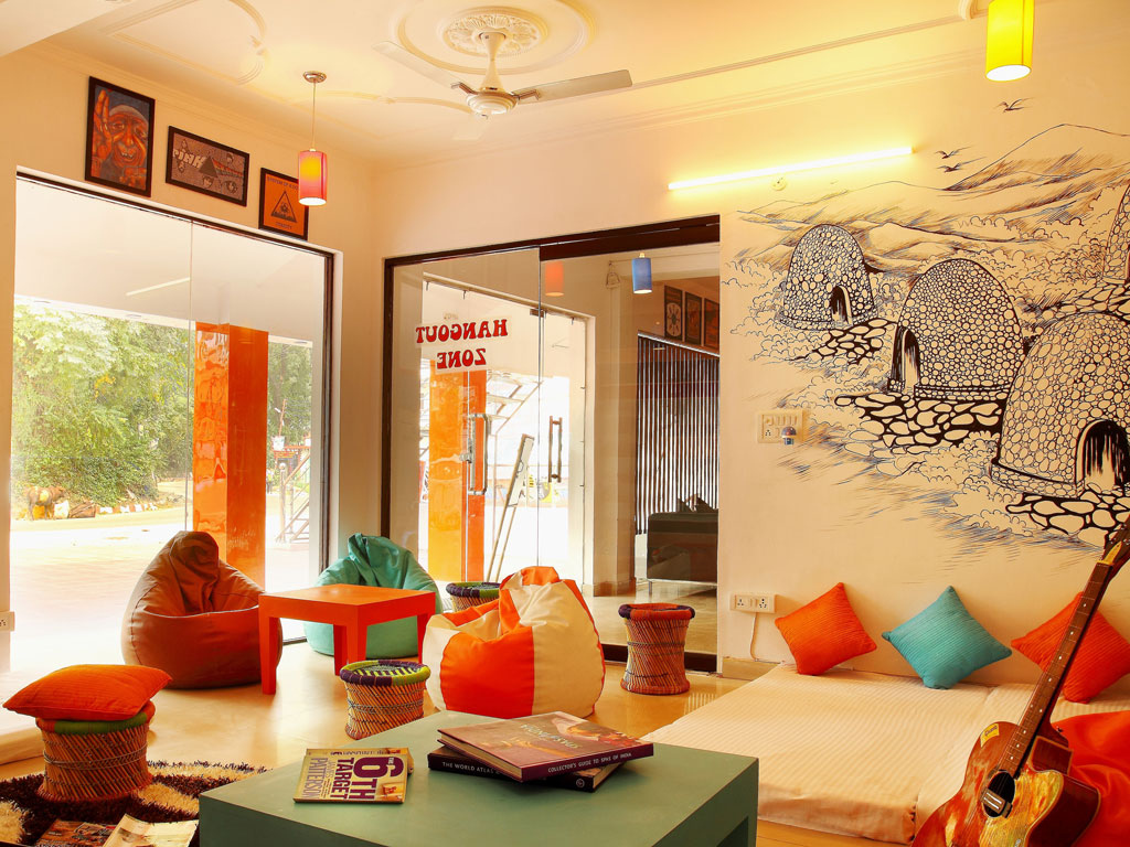Zostel's community room is colourful and inviting. Funky artworks adorn its walls. Photo Courtesy: Zostel