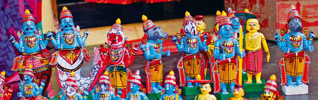 Seen here are painstakingly made brightly painted wooden toys of gods and goddesses. Photo by Swagata Ghosh