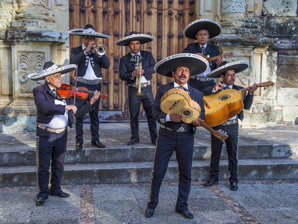 Mariachi bands are by far the most popular form of music in Mexico, often performing on streets to the delight of onlookers. Photo By: Kobby Dagan/Shutterstock