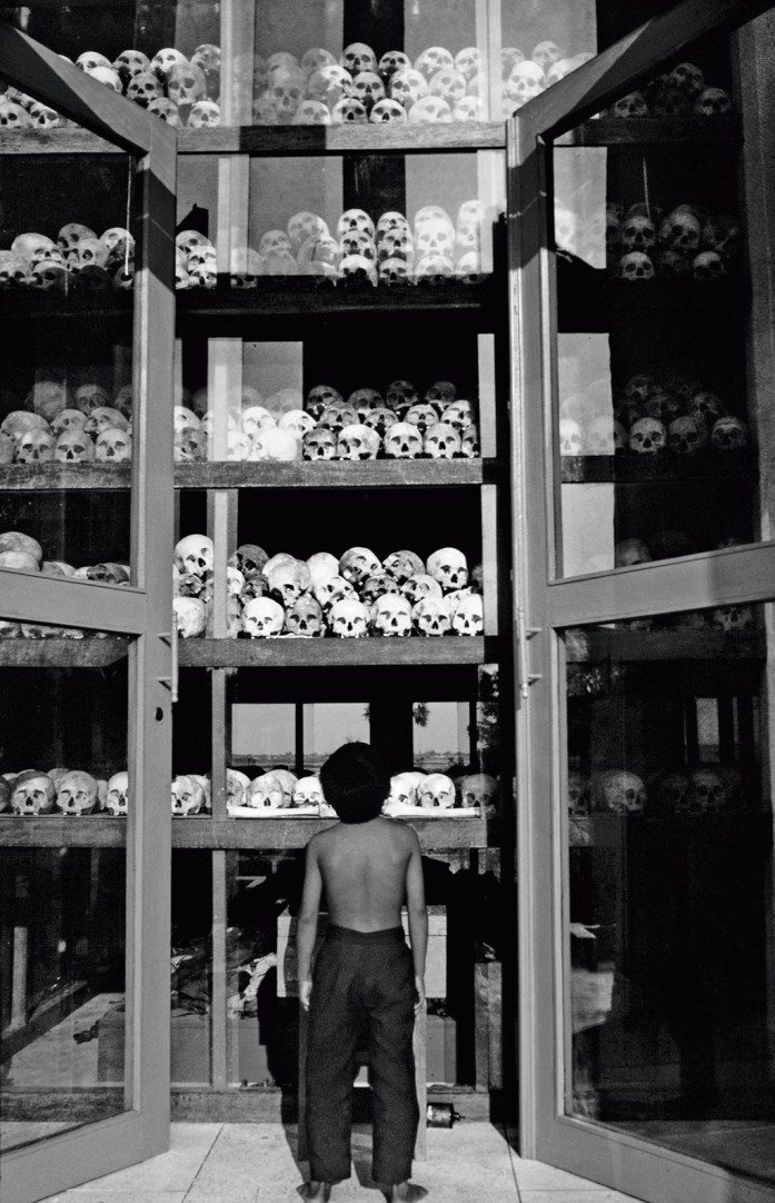 The skulls of over 5,000 victims of the Khmer Rouge genocide are preserved in a memorial at Choeung Ek, a mass grave uncovered south of Phnom Penh. Photo: Andrew Holbrooke/ Corbis Wire/ Corbis/ Imagelibrary