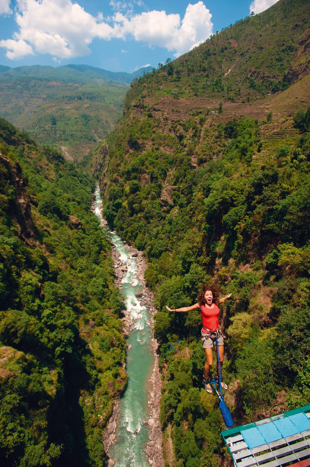 CY2RC8 A woman leaps backwards from a bungy jumping bridge in Nepal.