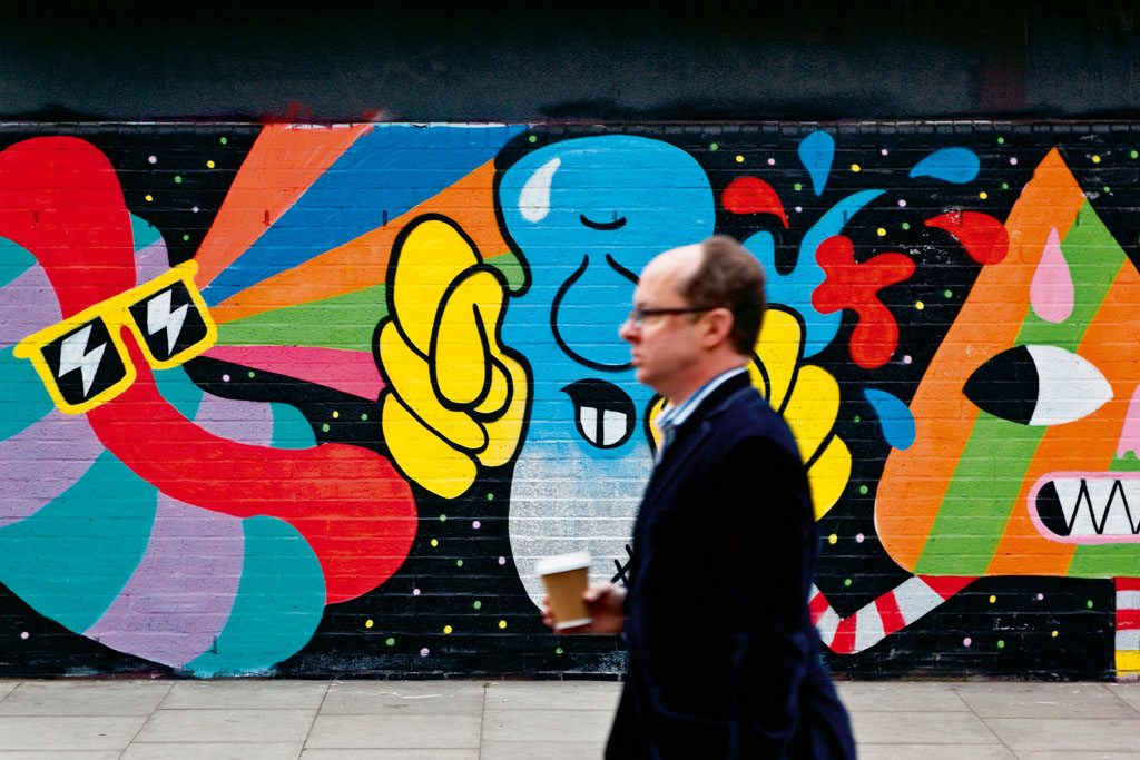 Graffiti brightens up Brick Lane. Photo: Luis Davilla/AGE Fotostock/Dinodia