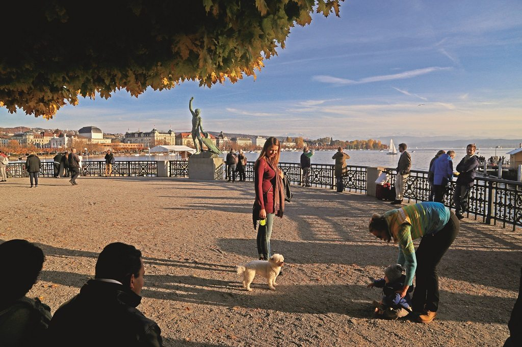 The promenade around Burkliplatz is a hub of activity as residents and visitors gather to take a boat ride, walk their dog, or go for a run around Lake Zurich. Photo: Chirodeep Chaudhuri
