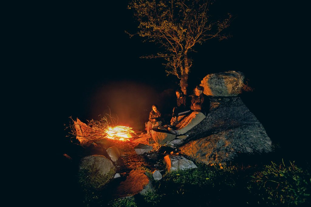 One of the fun aspects of camping in the park is gathering around the campfire and listening to the sounds of the jungle as dinner cooks. Photo: Gautam Pandey