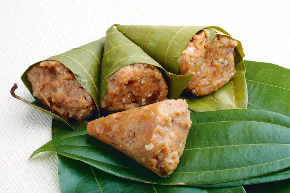 Round off the meal with Kumbiappams, steamed dumplings made of rice flour, jaggery, and coconut. Photo: STA/Shutterstock