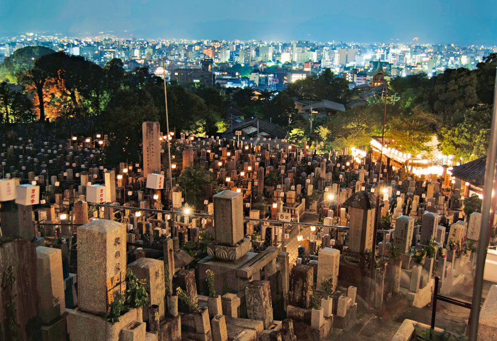 Lanterns in Kyoto illuminate a graveyard during Obon season, a time dead ancestors are said to visit their families on Earth. Photo: Andy Heather