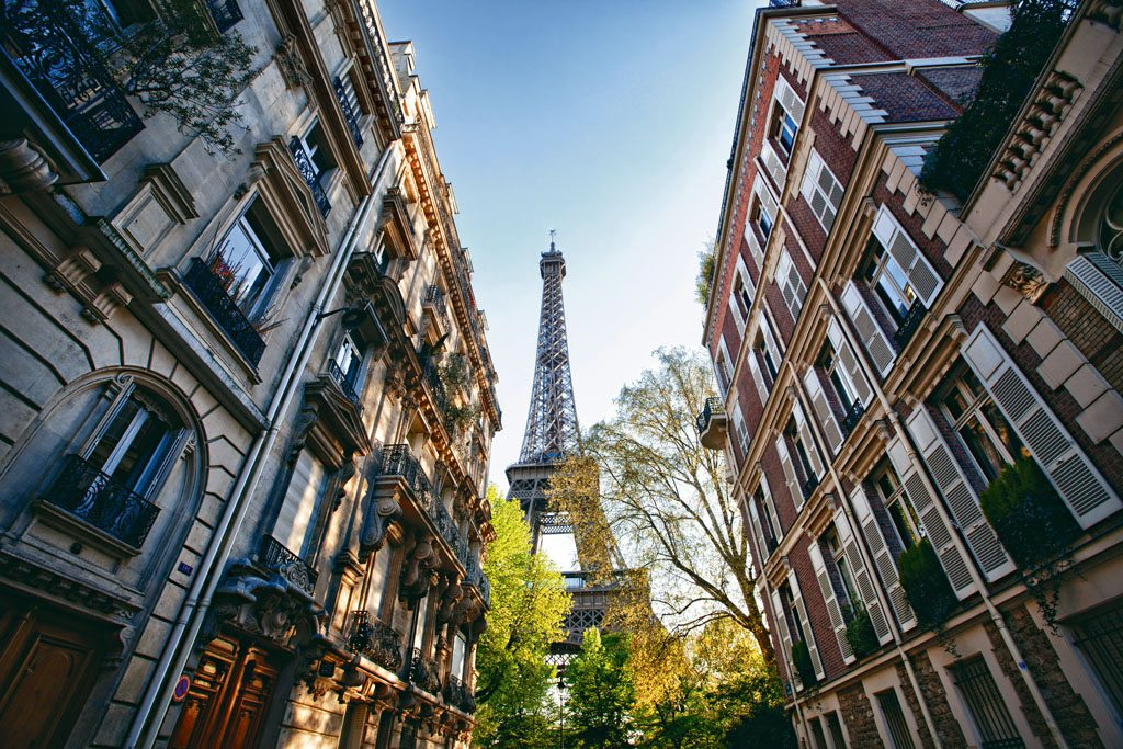 In the City of Light, stately apartment buildings line a leafy street with a majestic view of the Eiffel Tower. Photo: Scott Stulberg/Corbis