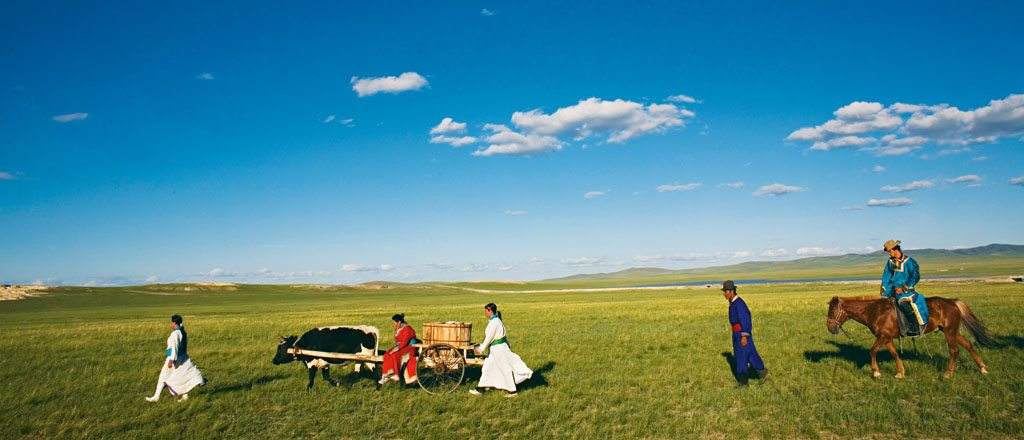 A nomadic herding family traverses a grassy plain in search of water, which will be transported on their bullock cart, in the north of Inner Mongolia. Photo: Palani Mohan/Getty Images