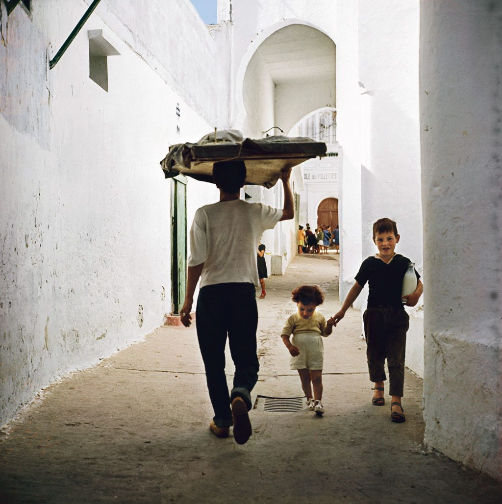Morocco, 1963—A boy guides his sibling along a narrow street in the Tangier medina. Photo: Roger Wood/Corbis