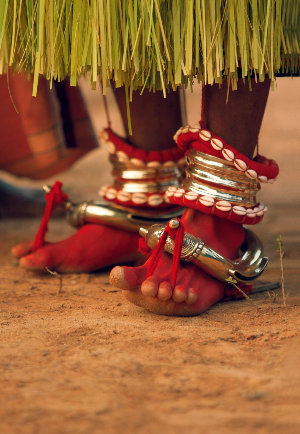 The different steps of a Theyyam are known as kalaasalams. They involve the systematic repetition of footwork. Photo: Scott Hailstone/E+/Getty Images