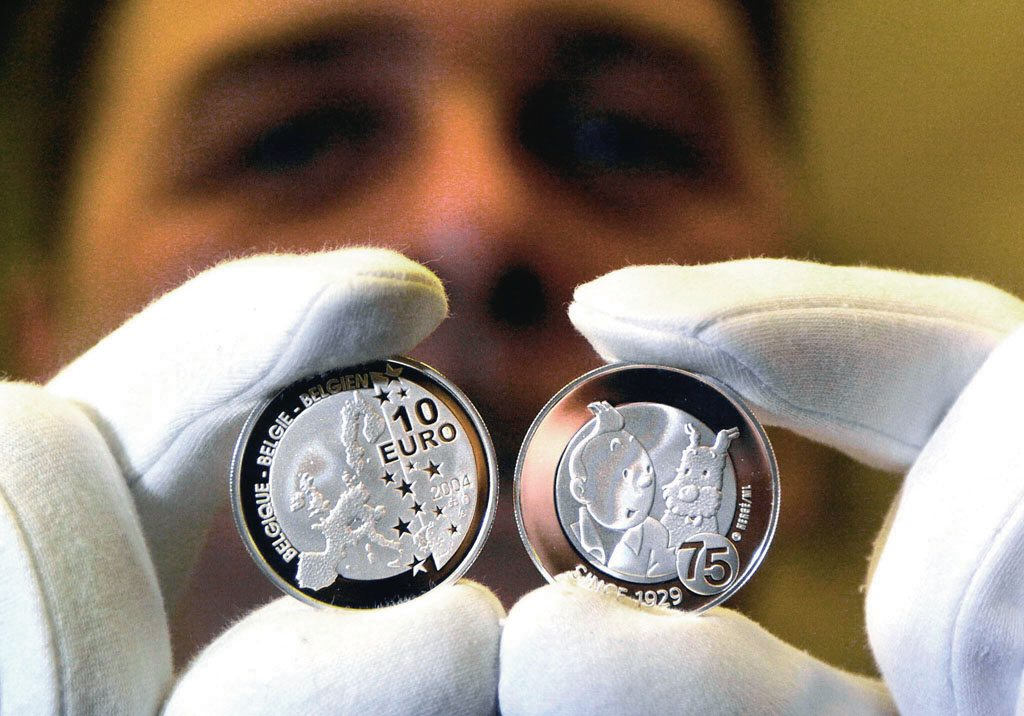 Royal Belgian Mint issued a 10 Euro commemorative coin of Tintin and Snowy on the former's 75th birthday in 2004. Photo: Benoit Doppagne/Staff/ AFP/IndiaPicture